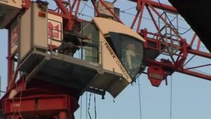 Woman charged after downtown Toronto crane rescue