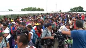 Officials say up to 7,000 now heading north to U.S. as migrant caravan swells in size once again
