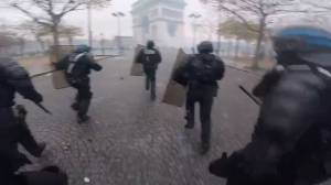 Police come under attack during protest at Arc de Triomphe