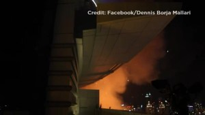 Photographer captures video of Dubai hotel fire dangling from a rope