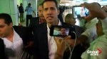 Venezuela's Guaido welcomed at Caracas airport by chanting supporters