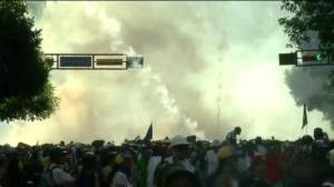 Protesters flee as plumes of tear gas fill air in Venezuela