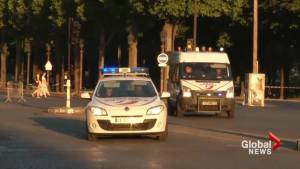 Police remove body of suspect in Champs-Elysees car ramming