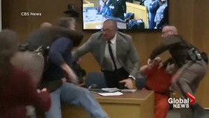 Victims' father lunges at convicted child molester Larry Nassar in court