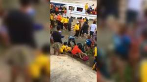 People scramble to get off Thailand tourist boat after capsizing