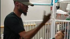Dancing dad celebrates son's release from hospital