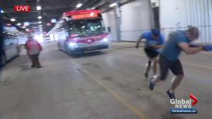 Calgary Transit employees warm up for a sweaty situation
