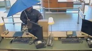 'Umbrella bandit' wanted in connection to Burnaby bank robbery