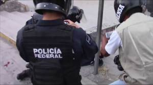 Protesters beaten by police as violence escalates in Mexico