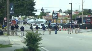 Police walk shoulder-to-shoulder searching for evidence in Orlando nightclub shooting
