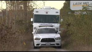 Kingston police recover body from wooded area