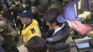 Jian Ghomeshi faces huge media scrum after surrendering to police
