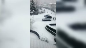 Car without driver slides backwards down snowy Metro Vancouver street