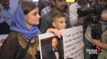 Yazidi boy who escaped ISIS capture greets cheering supporters at Winnipeg airport