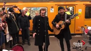 U2 surprises commuters on Berlin subway