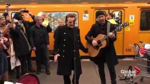U2 surprises commuters on Berlin subway