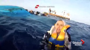 'Don't move': Overloaded migrant boat tips over, prompting dramatic Mediterranean rescue