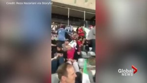 Female soccer fans watch Iran World Cup match in Tehran Stadium