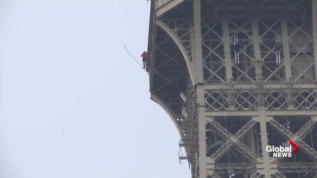 A climber scaled the heights of the Eiffel Tower