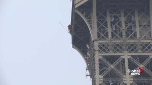 Trespasser climbs out on edge of Eiffel Tower
