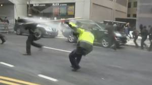 Trump inauguration: protester appears to fight back at pepper-spraying police