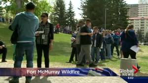 Calgary evacuees line up for debit cards from the province