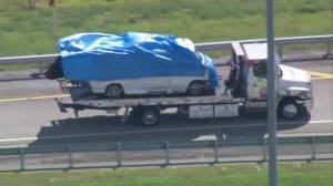 Tarp covering slips revealing images attached to the van connected to pipe bombs