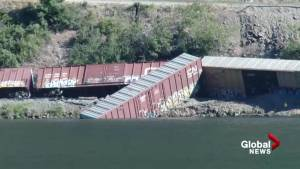 Crews clean up after train cars derail in B.C. lake
