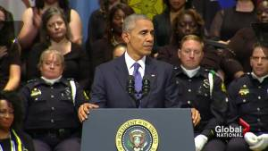 Obama aims to bridge divides during Dallas police shooting memorial