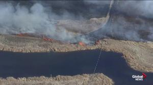 Grassfire burns east of Calgary