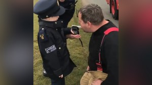 Irish boy conducts road checks with police one month after finishing chemotherapy for leukemia