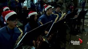 Calgary high school band helps 'de-stress' festive flyers