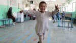 Afghan boy with prosthetic leg dances with joy after being injured during fighting in Afghanistan