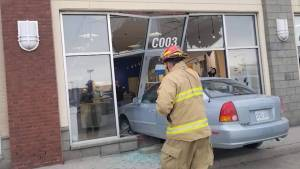 Vehicle crashes into Bell storefront in Kingston RioCan Centre