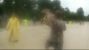 Rescuer carries baby deer to safety from Houston floods