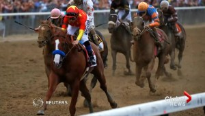 Justify charges to victory at Belmont Stakes to win Triple Crown