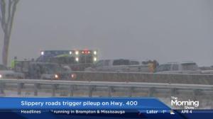 Slippery roads trigger pileup on Hwy. 400