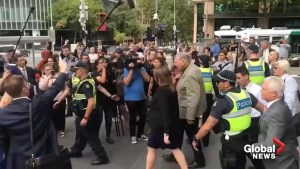'You're a Disgrace!': Cardinal Pell heckled while leaving Melbourne court