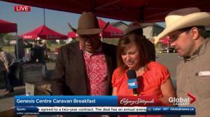Calgary Mayor Naheed Nenshi flips pancakes with Leslie Horton