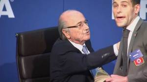 Blatter's news conference delayed by British comedian throwing dollar bills at FIFA president