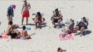 Chris Christie lounges on beach he closed to public
