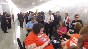 'We matter': Protest puts pause on U.S. Senate health care hearing