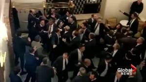 Turkish parliament passes controversial voting law, as brawl ensues
