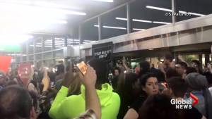 LaGuardia protesters sing as they await arrival of migrant children