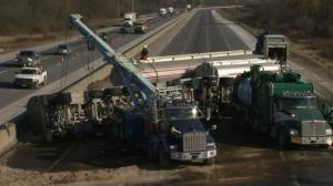 Crews clearing Hwy. 401 after tractor-trailer flips, spills jet fuel