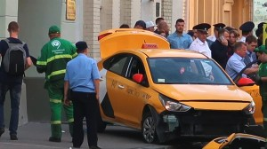 Taxi drives onto Moscow sidewalk leaving 8 injured as World Cup soccer fans crowd streets