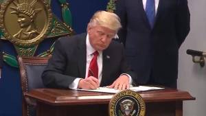 Justice Department begins legal fight in appeal of Trump travel ban ruling