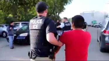 Children of undocumented migrants detained in record ICE raid rely
