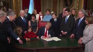 Trump inauguration: Schumer trades 'Ben Carson' pen for a 'good one'