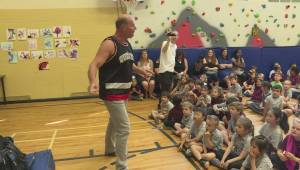 Pro-wrestler gives students a lesson on bullying (01:20)